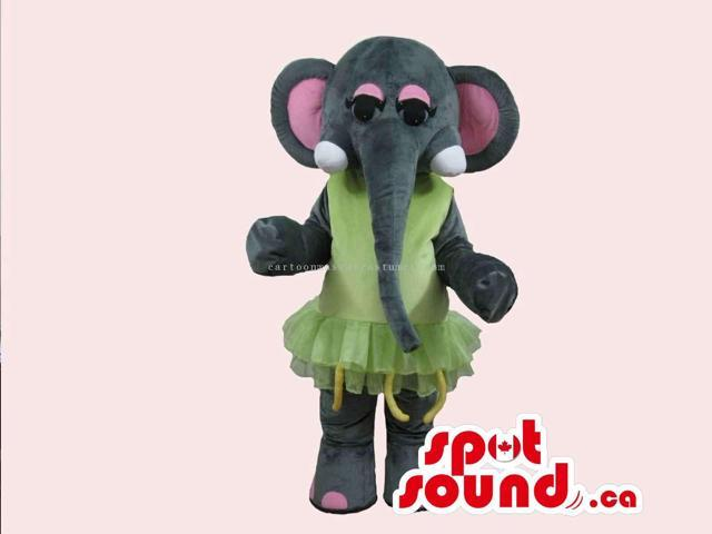 Cute Elephant Canadian SpotSound Mascot With Long Trunk Dressed In A Green Dress