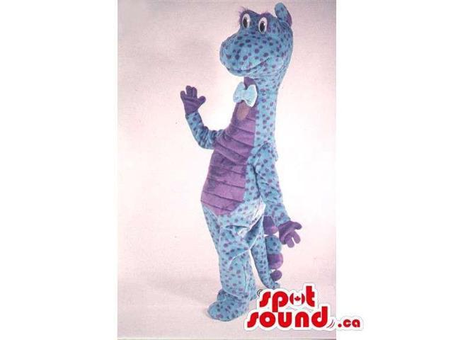Blue Dinosaur Canadian SpotSound Mascot With Purple Dots Dressed In A Bow Tie
