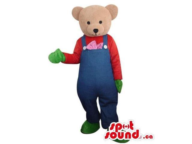 Light Brown Teddy Bear Dressed In Blue Overalls And Green Gloves