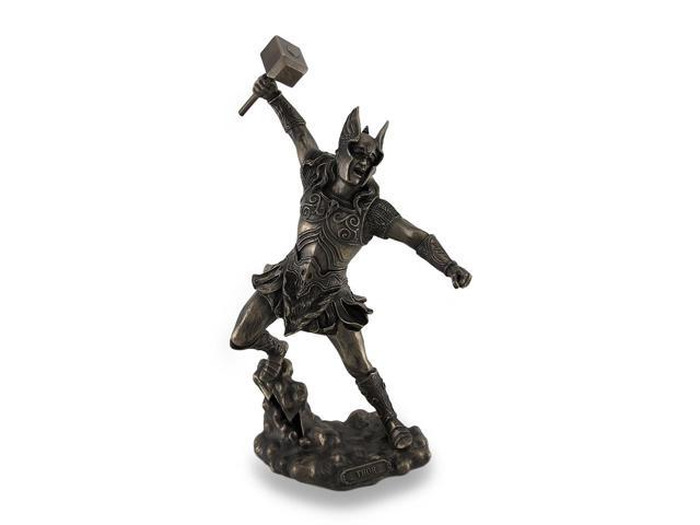 thor norse god of thunder wielding hammer sculptured