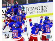 The New York Rangers celebrate after defeating the Montreal Canadiens in Game Six to win the Eastern Conference Finals of the 2014 NHL Stanley Cup Playoffs at M 9SIA1S74YN9134