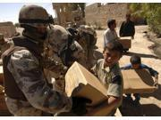 An Iraqi Army soldier handing a box of food to a boy of the Choloq tribe in Um Shababit, Iraq. Poster Print (16 x 12)