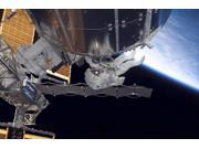 Astronaut participates in extravehicular activity Poster Print (16 x 11)