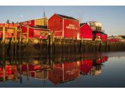 The fishing plant reflected in the Columbia River at the port of Ilwaco Ilwaco Washington United States of America Poster Print by Robert L Potts  Design Pics (