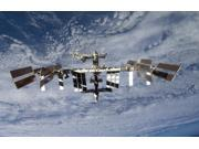 International Space Station backdropped against Earth Poster Print (17 x 11)