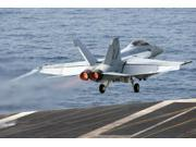 An FA-18F Super Hornet launches from the aircraft carrier USS Ronald Reagan Poster Print by Stocktrek Images (17 x 11)