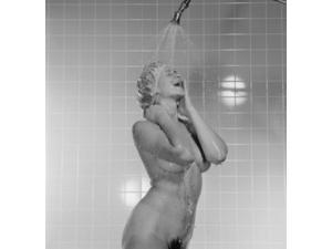 USA, Young naked woman taking shower Poster Print (24 x 36)