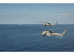 MH-60R Sea Hawk helicopters launch AGM-114 hellfire missiles Poster Print (34 x 22)