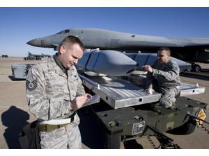 Weapons loaders inspect an AGM-158 JASSM Poster Print (34 x 23)