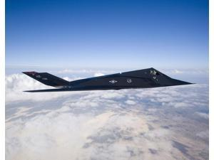 An F-117 Nighthawk stealth fighter in flight over New Mexico Poster Print (32 x 25)