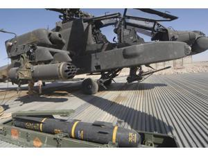 An AGM-114 Hellfire missile is ready to be loaded onto an AH-64 Apache Poster Print (34 x 22)