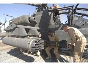 Aircrew loading an AGM-114 Hellfire missile onto an Apache helicopter Poster Print (34 x 22)