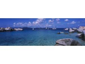 Rocks at the coast with boats in the background, The Baths, Virgin Gorda, British Virgin Islands Print by Panoramic