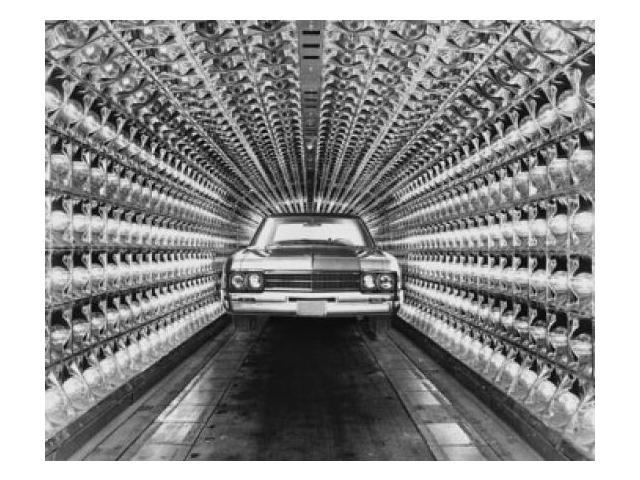 Car under heat lamps in a car paint drying unit of a factory Poster Print (18 x 24)