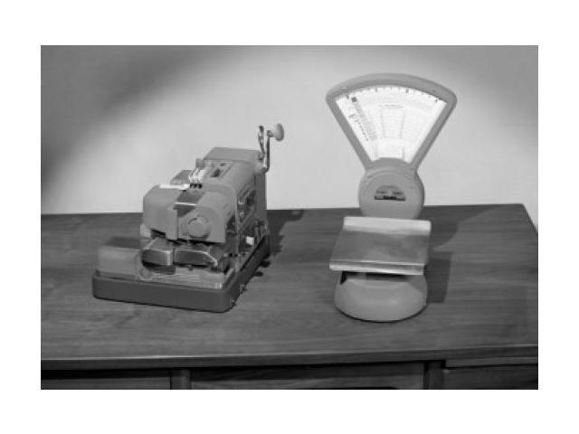 Mechanic device and weight scales on desk Poster Print (18 x 24)