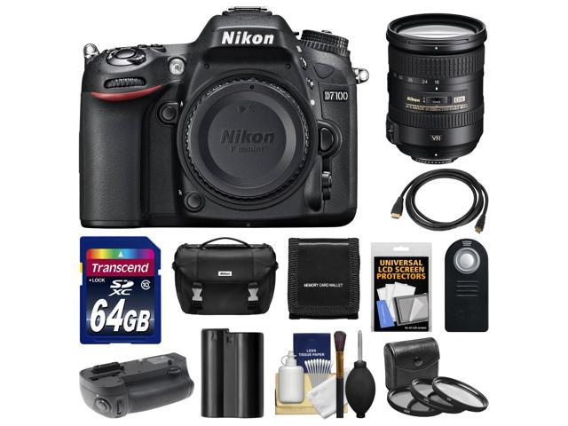Nikon D7100 Digital SLR Camera Body with 18-200mm VR Lens + 64GB Card + Case + Battery & Grip + HDMI Cable + Filter Set ...
